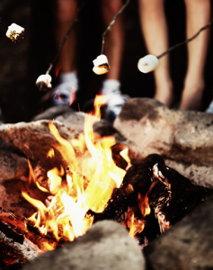 International summer camps - burning fire with marshmallow