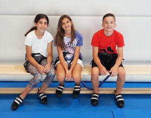Altitude Summer Camps - three kids getting ready to climb