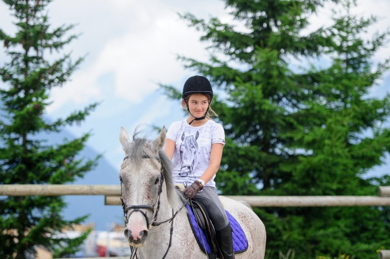 Activities in Verbier - girl riding a horse