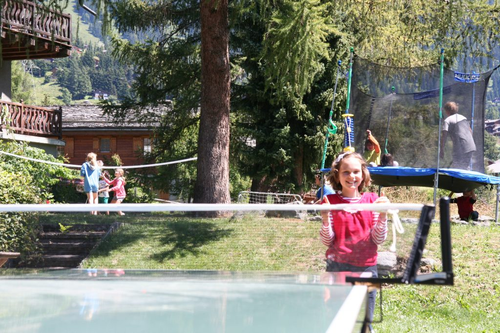 Altitude Residential Camps - girl playing table tennis in the garden