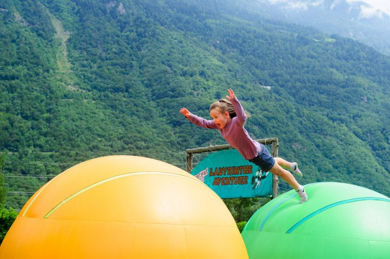Excursions in Switzerland - girl jumping on bouncy balls