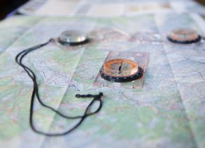 Altitude Camps - maps and compasses on a table