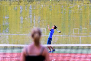 What to do in Verbier - teens playing tennis