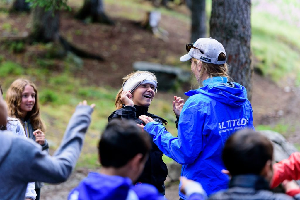 Day Camps Switzerland - blindfolded girl in the forest