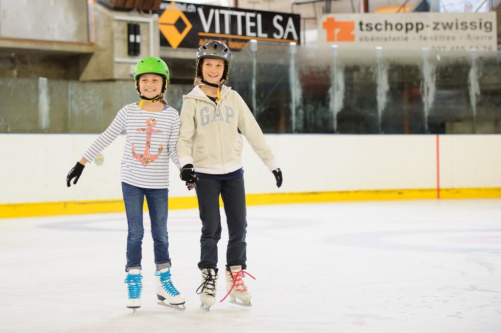 Residential camps - two girls ice skating