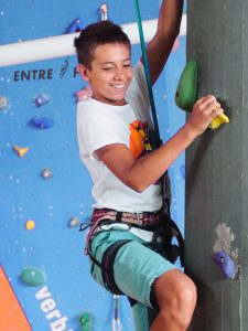 Activities and Excursions - boy climbing an indoor climbing wall