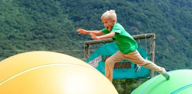 Excursions in Switzerland - boy jumping on bouncy balls