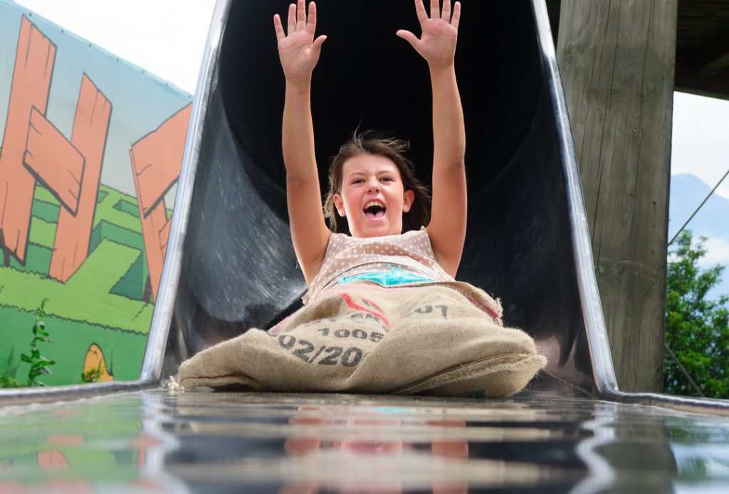 Swiss Summer Camps - Girl screaming down slide