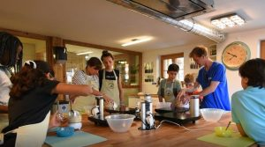 Altitude Camps Blog - kids preparing food in the kitchen