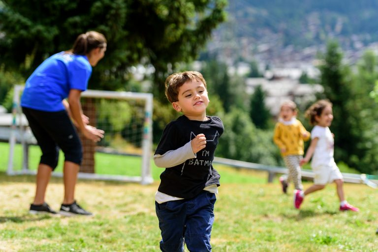 Altitude Camps Testimonials - young boy smiling and running in the garden