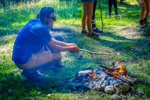 Altitude Camps - staff toasting marshmallows on a fire