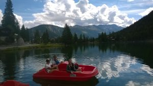 Champex Lac - kids in a boat on the lac